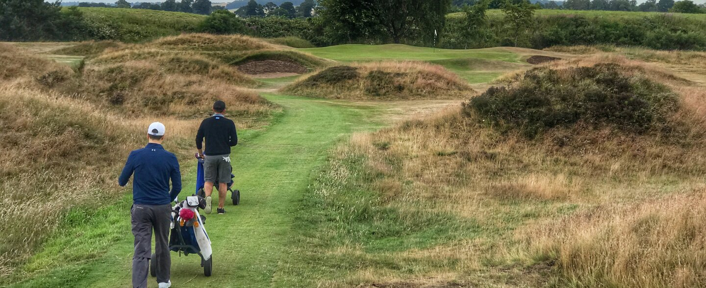 Golfers walk the course at Panmure, Scotland